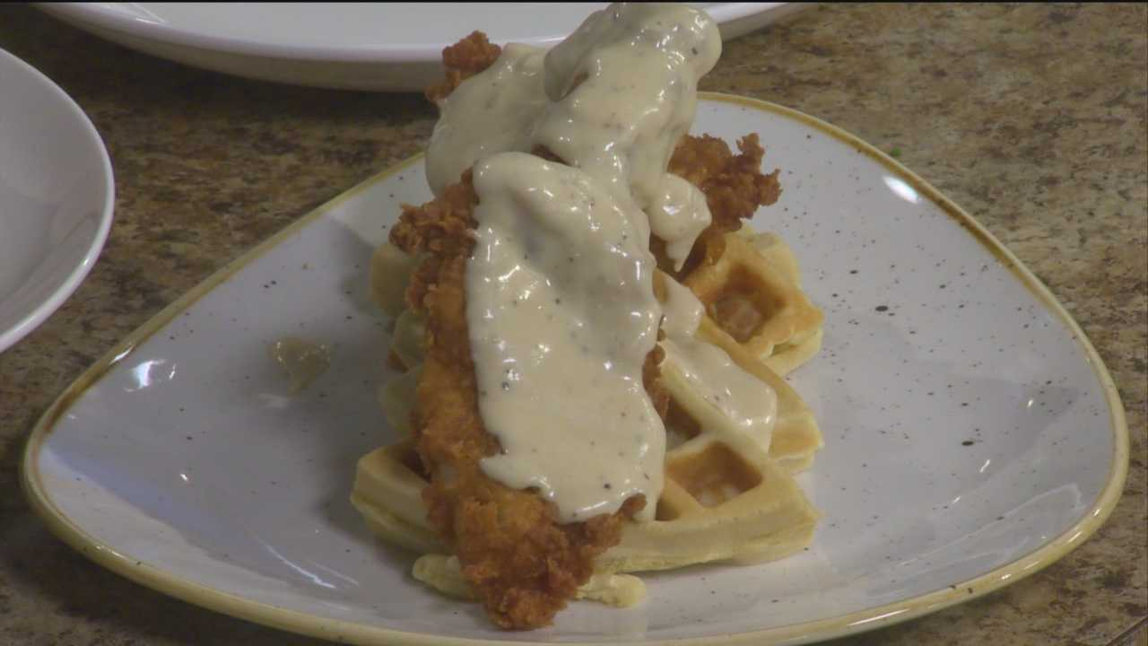 Chef Kyle Algaze from the Iron Rooster makes chicken and waffles.