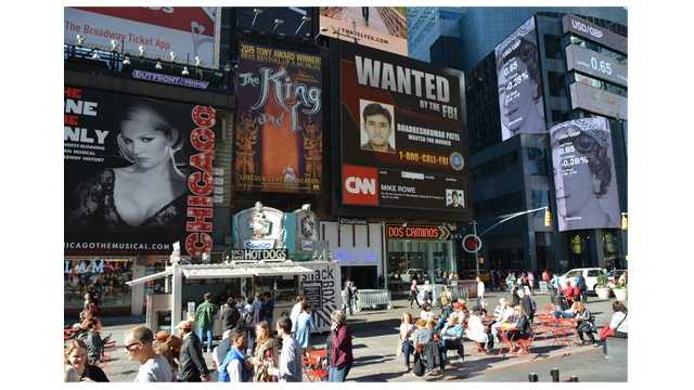 The FBI has placed a wanted poster in Times Square in New York as they continue to search for  Bhadreshkumar Chetanbhai Patel, who is wanted in the April 12 death of his wife, Palak, at a Dunkin' Donuts in Hanover.