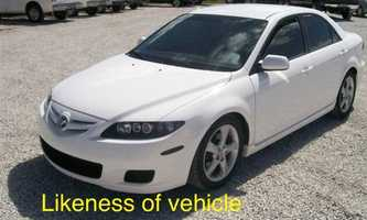 The stolen car is described as a white, four-door, 2008 Mazda 6 with a Maryland temporary tag of 5CD0004 and is similar to one pictured above.