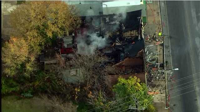 A row of vacant homes were destroyed Monday after a three-alarm fire in south Baltimore.