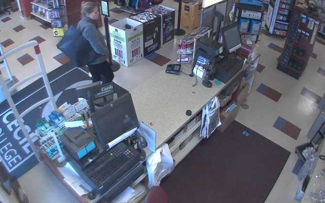The man distracted an employee while the woman went behind a counter and took the calculators.