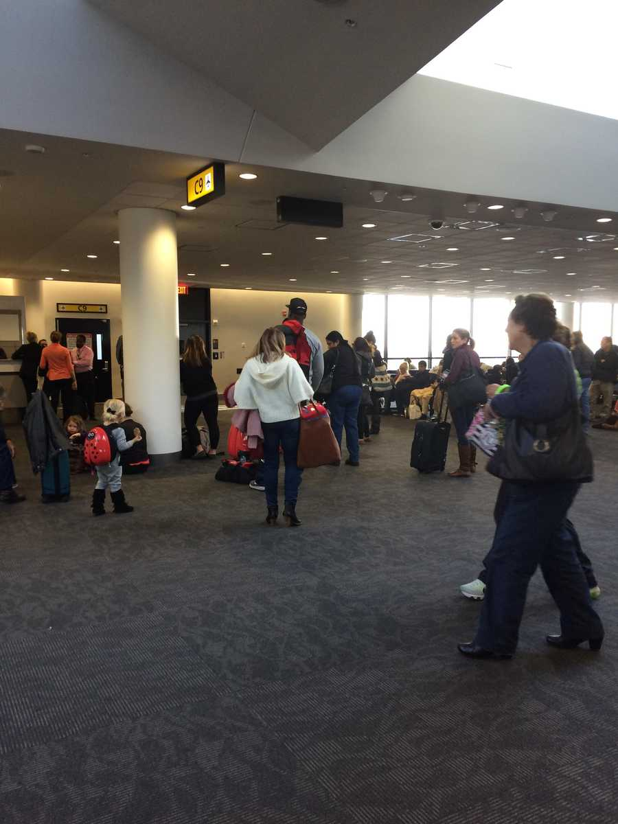 Passengers wait inside BWI Marshall after their Spirit Airlines flight was evacuated on Tuesday.