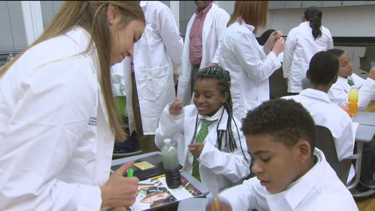 A group of sixth graders from Green Street Academy in west Baltimore are part of the University of Maryland, Baltimore and National Cancer Institute's CURE Scholars program. The program is designed to help promote diversity in the health care workforce and provide students with a mentor that will help them for years to come.