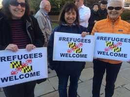 Demonstrators converged on Lawyers Mall in Annapolis Friday urging Gov. Larry Hogan to reconsider his stand on keeping Syrian refugees out of Maryland.