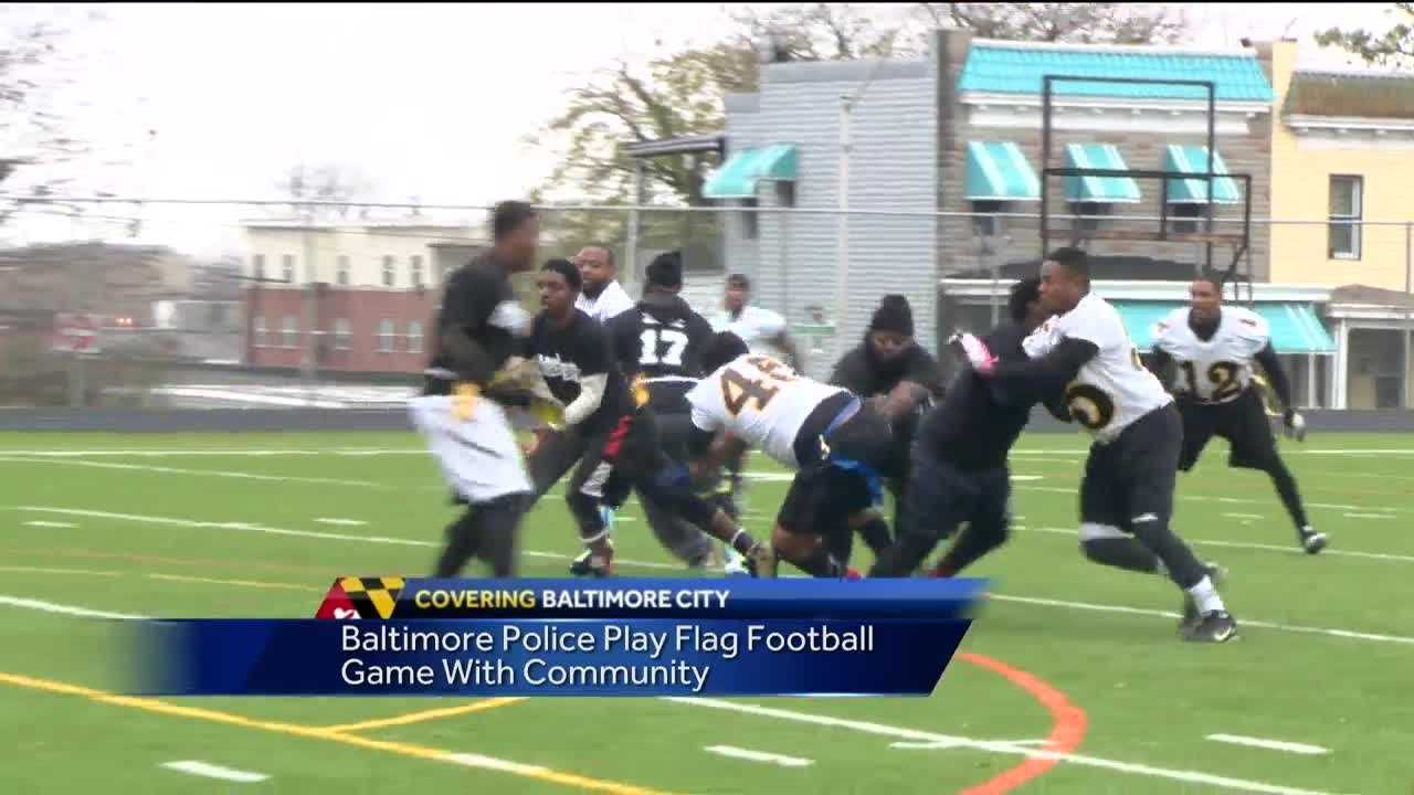 Baltimore police officers played a flag football game with members of the community at the Unity Bowl Sunday in an effort to bring people together.