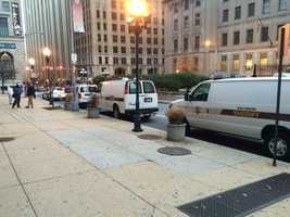 Baltimore Sheriff's vans line the outside of the Mitchell Courthouse prior to the start of the trial of Officer William Porter.