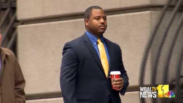 Officer William Porter walks into court
