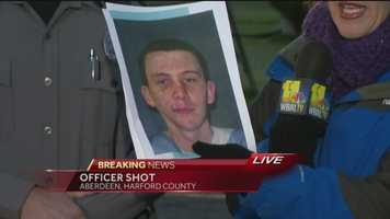Aberdeen police are searching for a man who they said shot a police officer in the face.