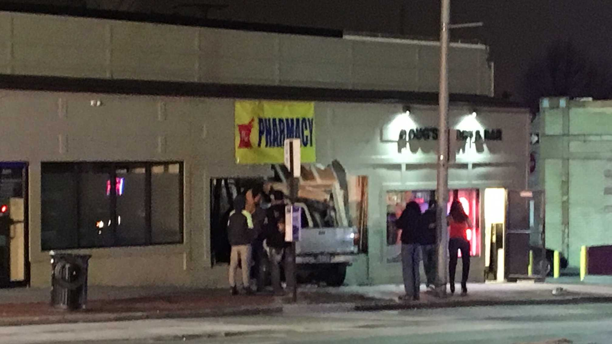 A pickup truck lost control and crashed into a northeast Baltimore strip mall Wednesday night.