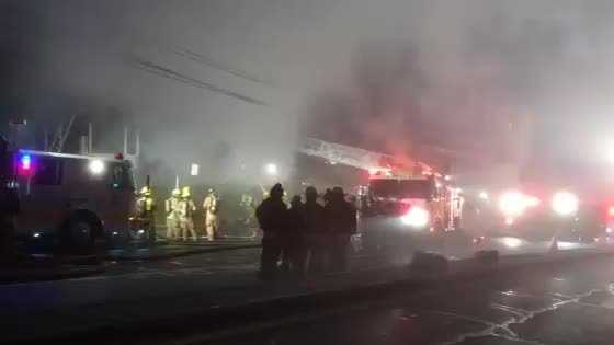 Firefighter are battling a two-alarm fire Wednesday morning in Brooklyn Park.