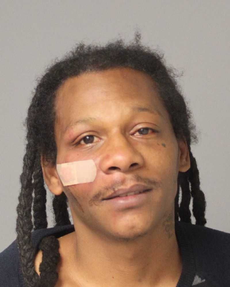 Carlton Kelvin Spriggs, 38, of Glen Burnie, is charged with multiple weapons and drug charges.