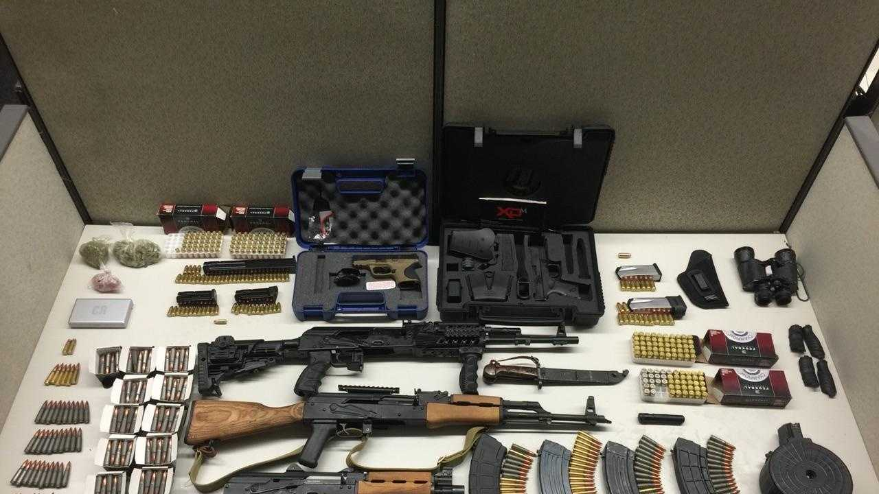 Authorities seized a 7.62 caliber Saiga rifle, 7.62 caliber Romarm/Cugir rifle, C.A.I. 7.62 caliber handgun, Smith and Wesson 9mm handgun, Springfield XD .45 caliber handgun, 415 live 7.62 caliber cartridges, 143 live 9mm cartridges, 117 live .45 caliber cartridges, bayonet with sheath and 37 .8 grams of marijuana, from two men while serving a search warrant Friday.