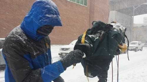 There are many challenges covering snowstorms, a big one is keeping the camera lens clear.
