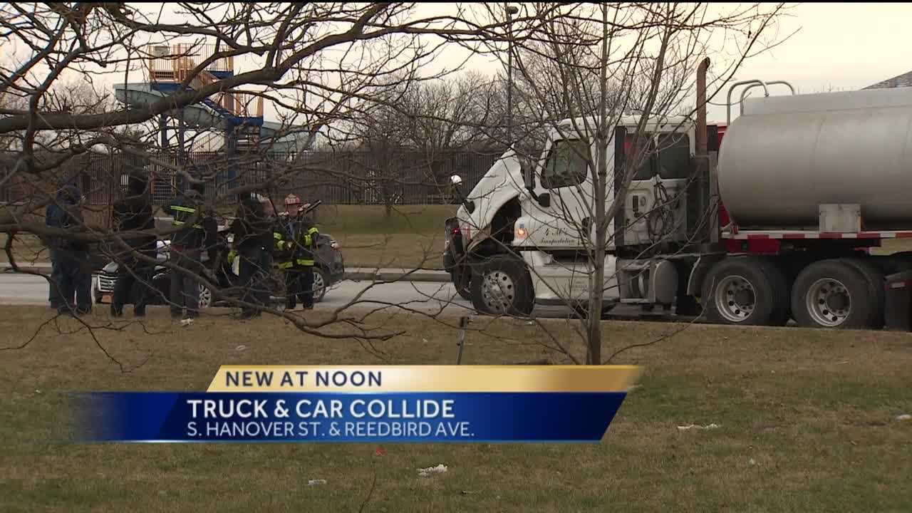 Three people were trapped Wednesday after a car collided with a tanker truck in south Baltimore.