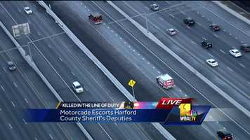 SkyTeam 11 shows a motorcade escorting the two slain sheriff's deputies to Harford County.