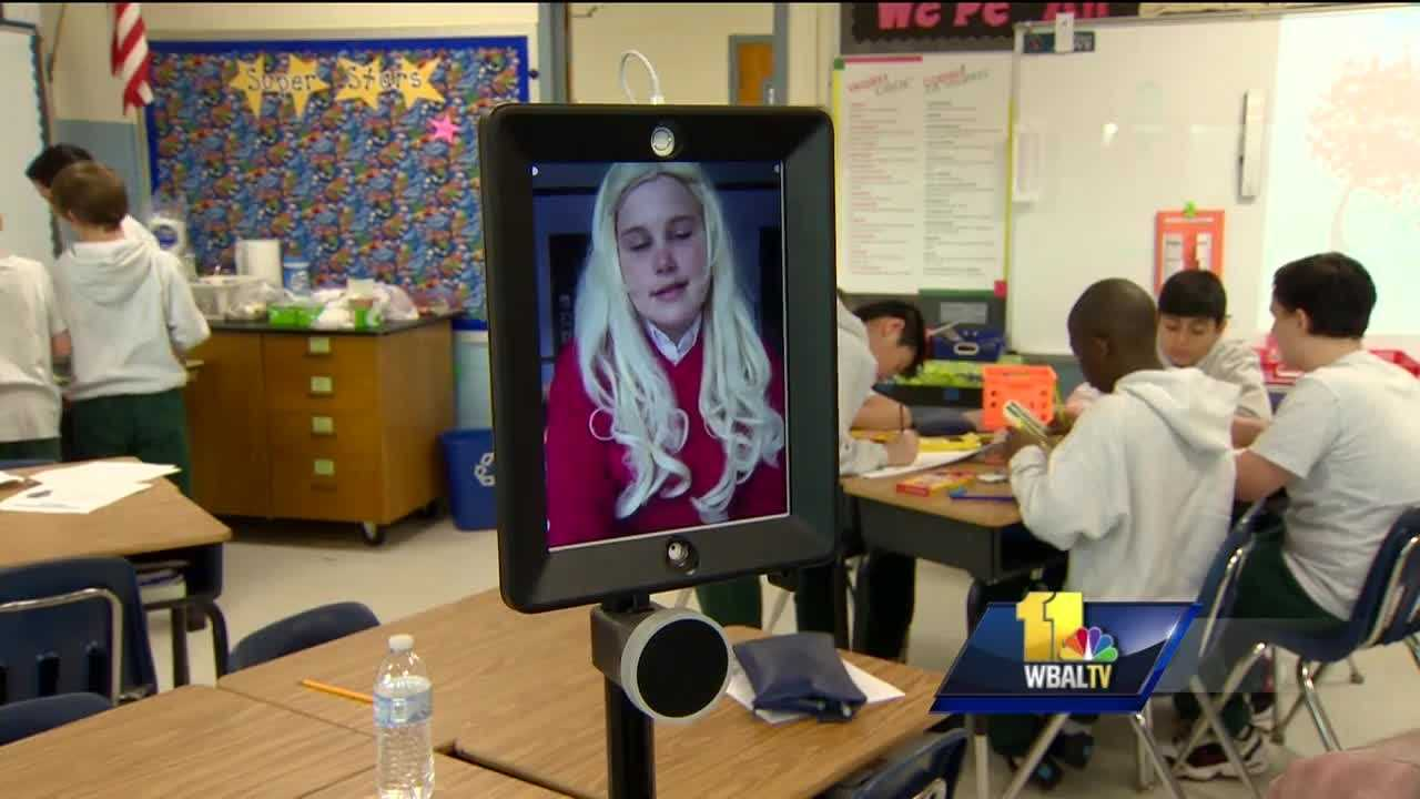 A robot is helping chronically ill students keep up with school by attending class when they can't. A Maryland sixth-grade student said it's easing the burden of her illness. The sixth-grade students at Monsignor Slade Catholic School are bringing ancient Egypt to life inside their classroom. Teacher Laura Briggs expects every student to participate. Emily Kolenda is keeping up with her class through a robot, a device that consists of an iPad on wheels that she controls from home.