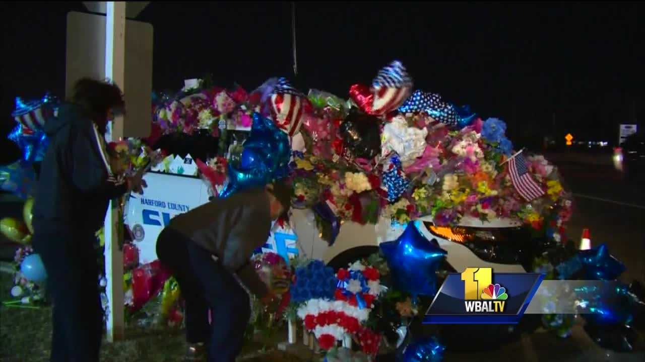 Residents, law enforcement members and others braved the freezing cold to attend a candlelight vigil in memory of two Harford County Sheriff's Office deputies who were fatally shot Wednesday in Abingdon. Senior Deputy Patrick Dailey and Senior Deputy Mark Logsdon were the first from their office to be shot and killed in the line of duty since 1899.