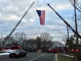An American flag hangs outside the entrance of Mountain Christian Church in joppa prior to the funeral of Harford County Sheriff's Office Senior Deputy Patrick Dailey