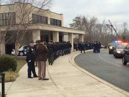 Police prepare to enter Mountain Christian Church in Joppa prior to the funeral of Harford County Sheriff's Office Senior Deputy Patrick Dailey.
