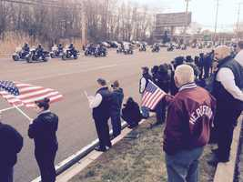 People line Belair Road as they watch the funeral procession of Harford County Sheriff's Office Senior Deputy Patrick Dailey.