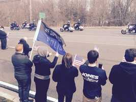 Residents show their support for police as they watch the funeral procession of Harford County Sheriff's Office Senior Deputy Patrick Dailey.