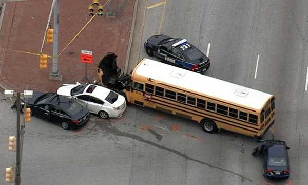Several people were injured in a multi-vehicle crash involving a school bus in Baltimore.