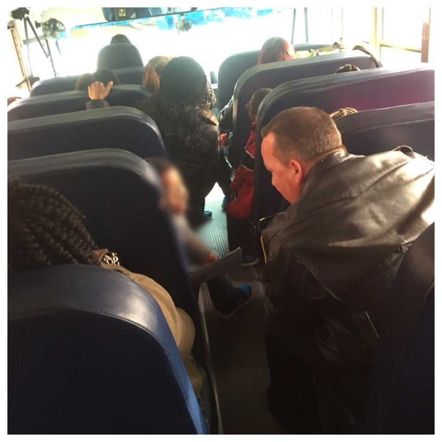 A second bus arrived to transport the students and teachers from the scene. Baltimore Police Commissioner Kevin Davis rode along with the children.