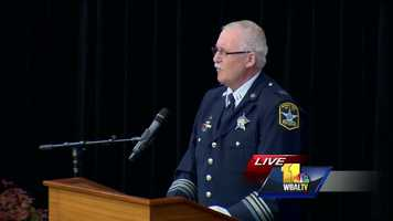 Capt. Mike Crabbs, commander of the Community Services Division, speaks at the funeral for Deputy First Class Mark Logsdon.
