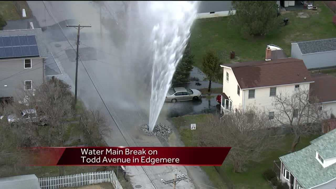 A water main break on Todd Avenue near Fort Avenue in Edgemere, Baltimore County, is gushing water straight up into the air.