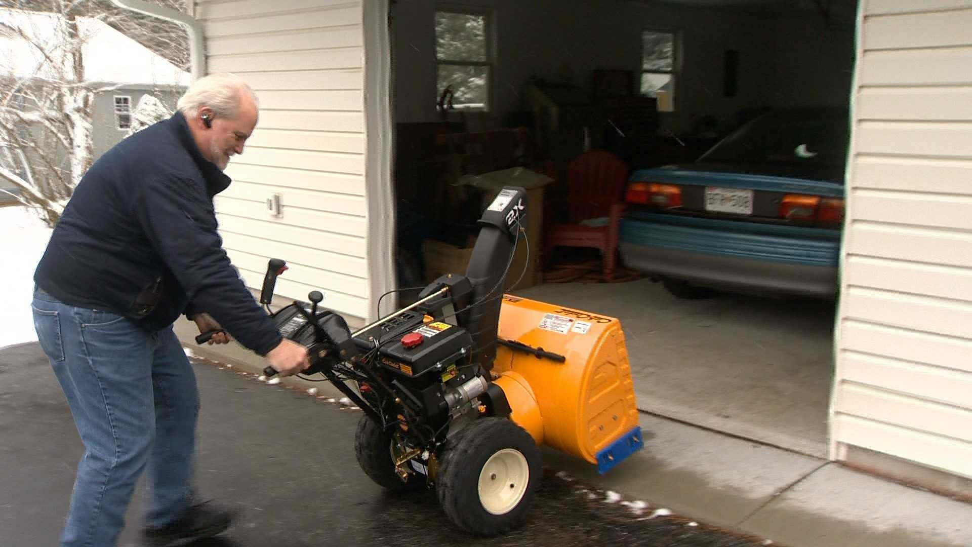 John Zacharais, of Westminster, is hoping he put his newly-bought snowblower away for the last time this season after a light snow blanketed the area Friday.