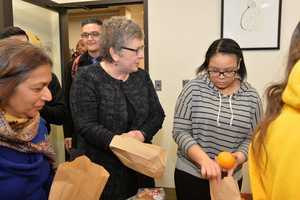 Towson University President Kim Schatzel joined the Muslim Student Association to package meals and hygiene products for those in need for the Feeding Our Neighbors event.