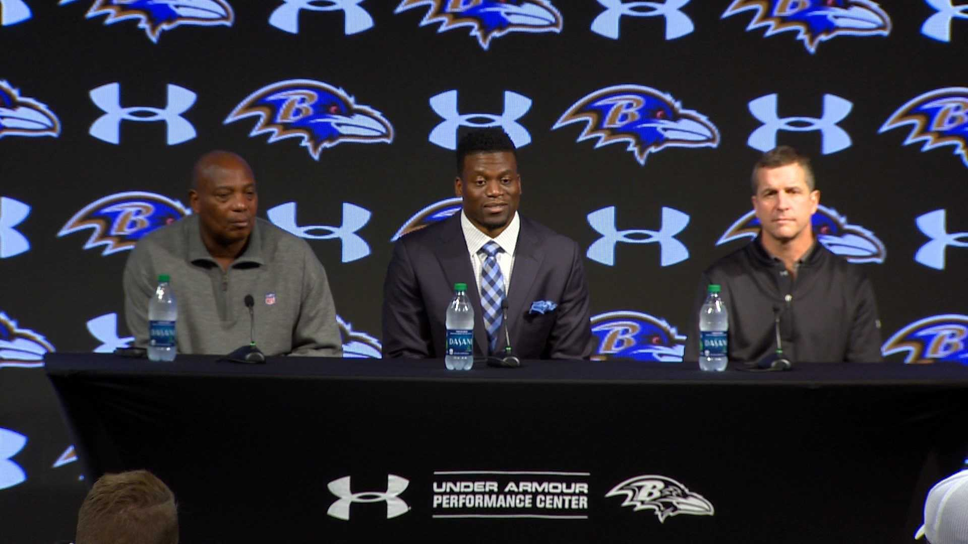 New Ravens tight end Ben Watson (center) addresses the media after signing a two-year deal with the team. Watson is joined at the news conference by general manager Ozzie Newsome (left) and coach John Harbaugh (right).