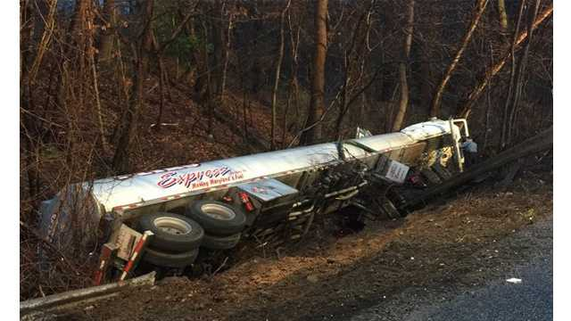 A portion of Route 3 south in Gambrills was closed after a tanker truck overturned on Monday.
