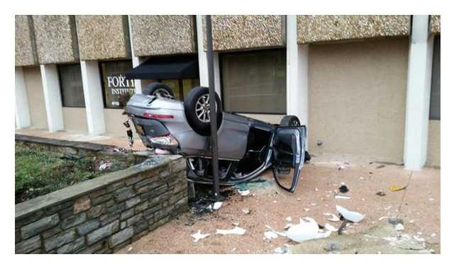 A driver was taken to the hospital after the car she was in fell out of a parking garage Monday in Towson.