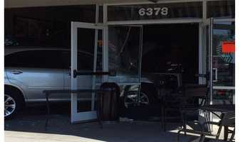 Four people were injured Monday after a vehicle crash into a Starbucks in Towson.