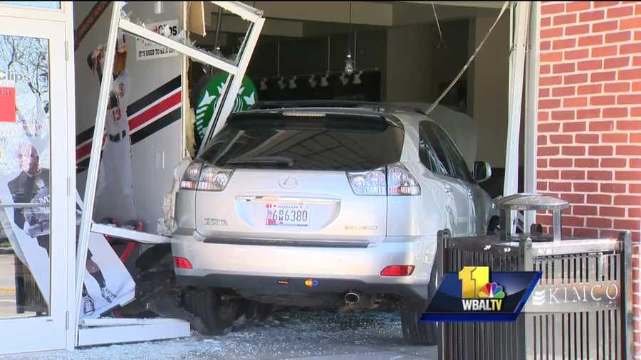 A vehicle slammed into a Towson Starbucks injuring four people, official said.