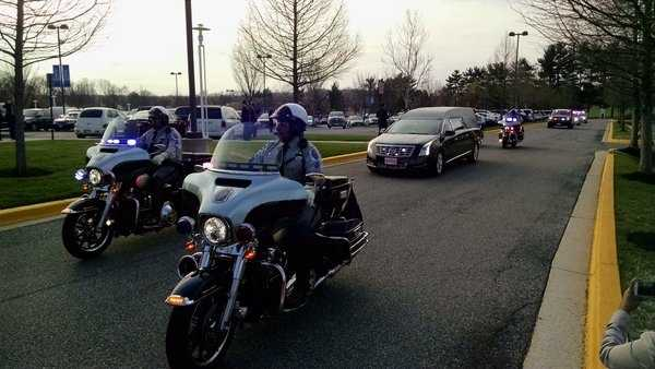 The body of Prince George's County police Officer Jacai Colson arrives for his funeral