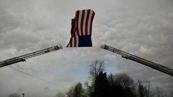 An American flag flies outside prior to the funeral of Prince George's County police Officer Jacai Colson.