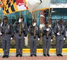 The Maryland Transportation Authority Police Honor Guard stands at attention outside the funeral of Prince George's County police Officer Jacai Colson.