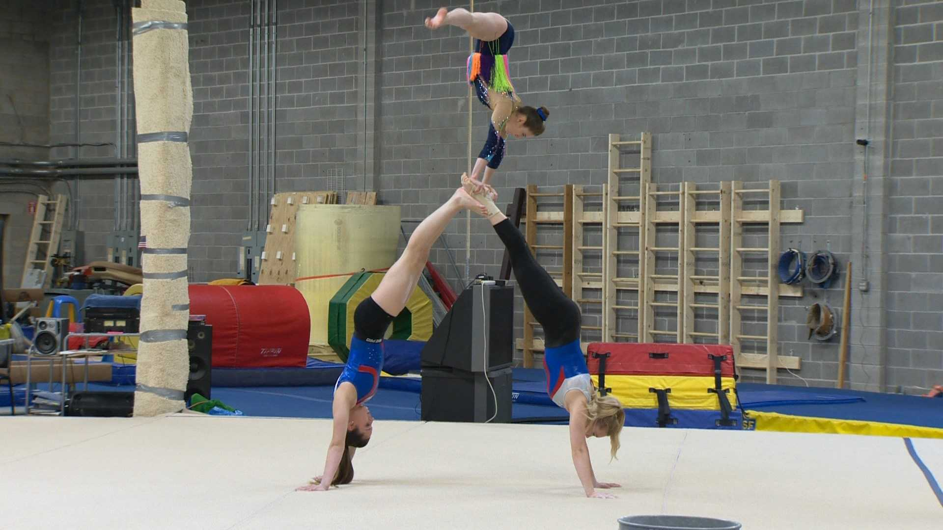 Gymnasts at Emilia's Acrobatics in Columbia practice in preparation for competing in the World Acrobatic Gymnastics Championships in China.