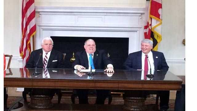 Gov. Larry Hogan is joined by Senate President Mike Miller, left, and House Speaker Michael Busch as he signs 100 bills into law from the 2016 General Assembly session.
