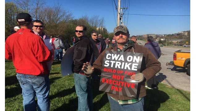Verizon workers walk the picket line outside a Verizon location in Cockeysville. The group is among the 39,000 Verizon workers that went on strike on Wednesday.