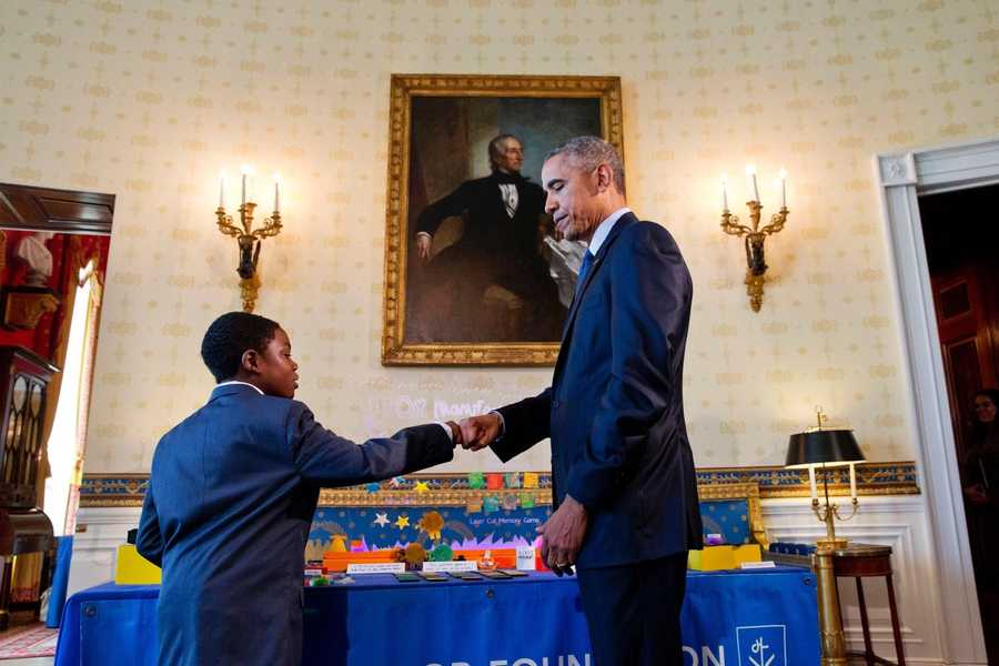 Jacob Leggette fists bump President Barack Obama at the White House Science Fair.