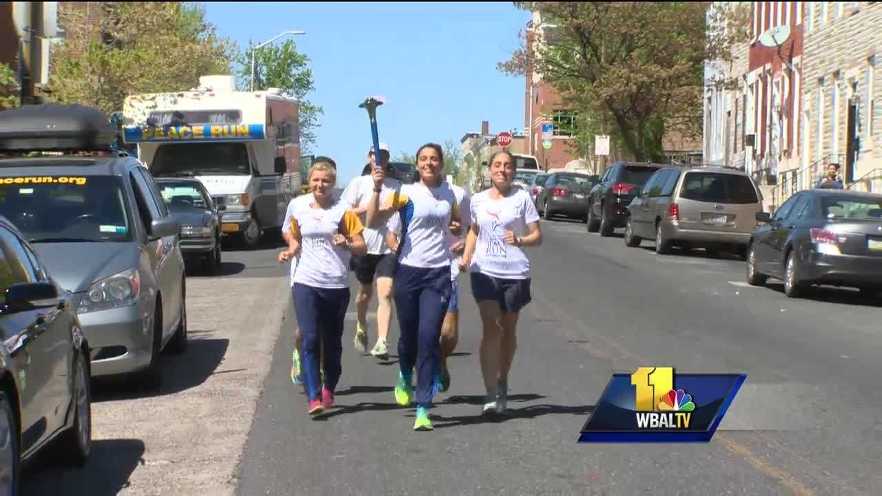 Twelve runners from 10 countries who are running across North America made one of their first stops in Baltimore. The runners are going 10,000 miles carrying a torch and a message. The Sri Chinmoy Oneness-Home Peace Run is slowly weaving its way across North America and, along the way, into the lives of children, like the students at Matthew A. Henson and Gilmor elementary schools, in Baltimore.