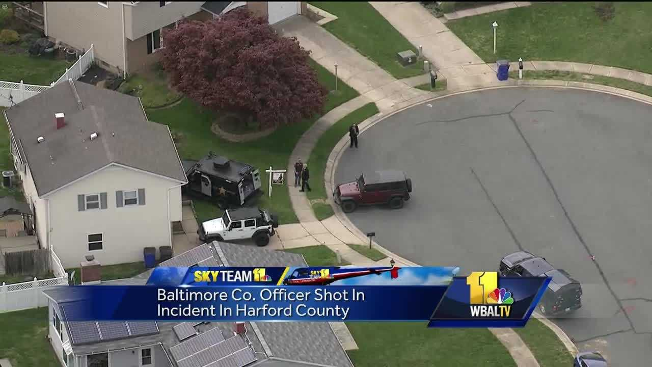 Deputies in Harford County shot and injured a Baltimore County police officer they said fired gunshots inside a Bel Air house during a barricade situation