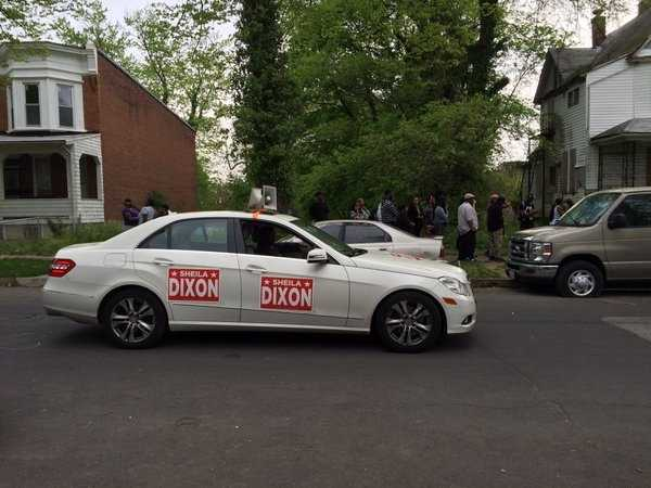 A supporter of former Mayor Sheila Dixon tries to encourage voters to back their candidate.