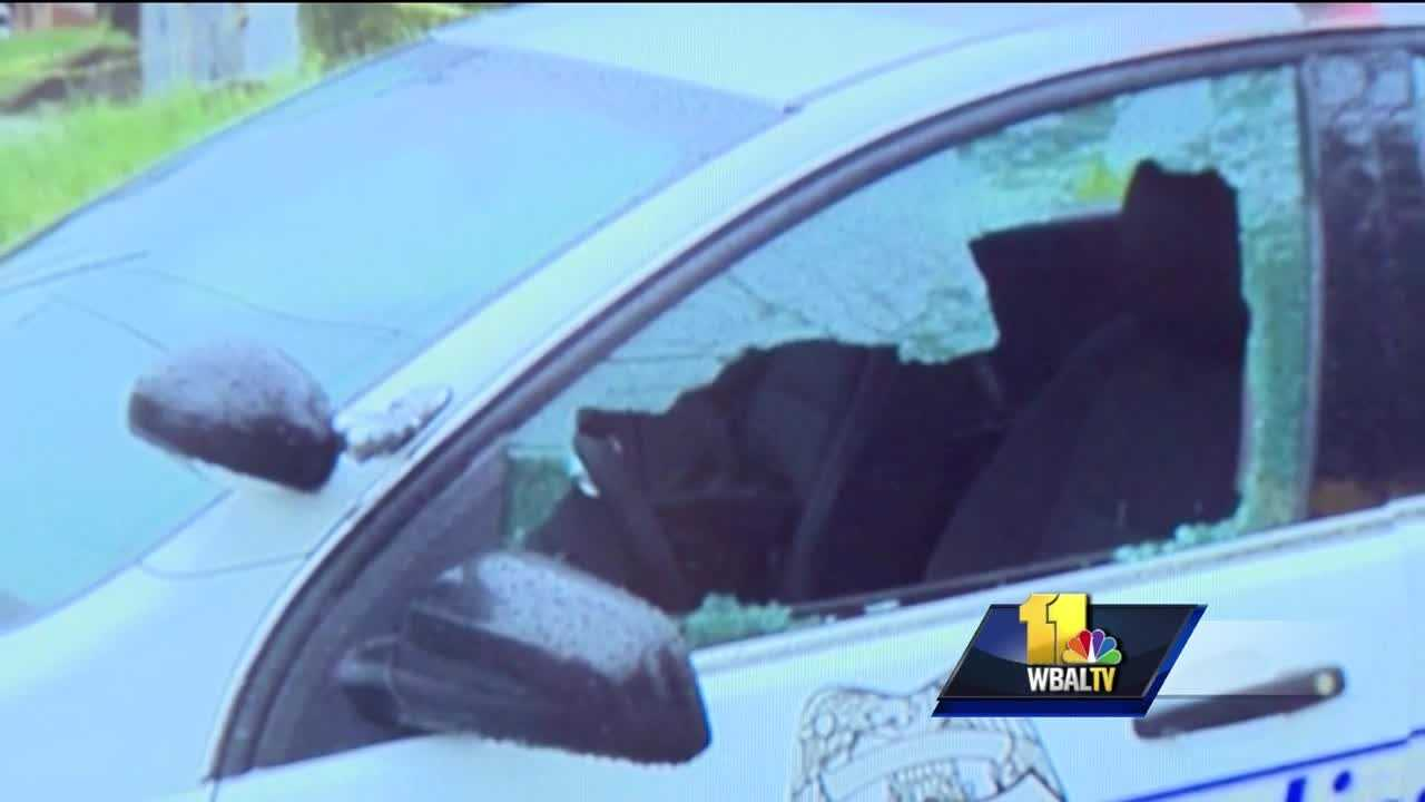 "Authorities are investigating a shooting Sunday involving a Baltimore police officer as a ""suicide by cop"" situation. Police said a patrol officer in his 20s was writing reports in his marked car around 9:30 a.m. on Ulman Avenue between Reisterstown Road and Park Heights Avenue. Investigators said the officer noticed a man pointing a gun at him. They said the officer fired his weapon through the window of his patrol car and struck the gunman three times in the chest."