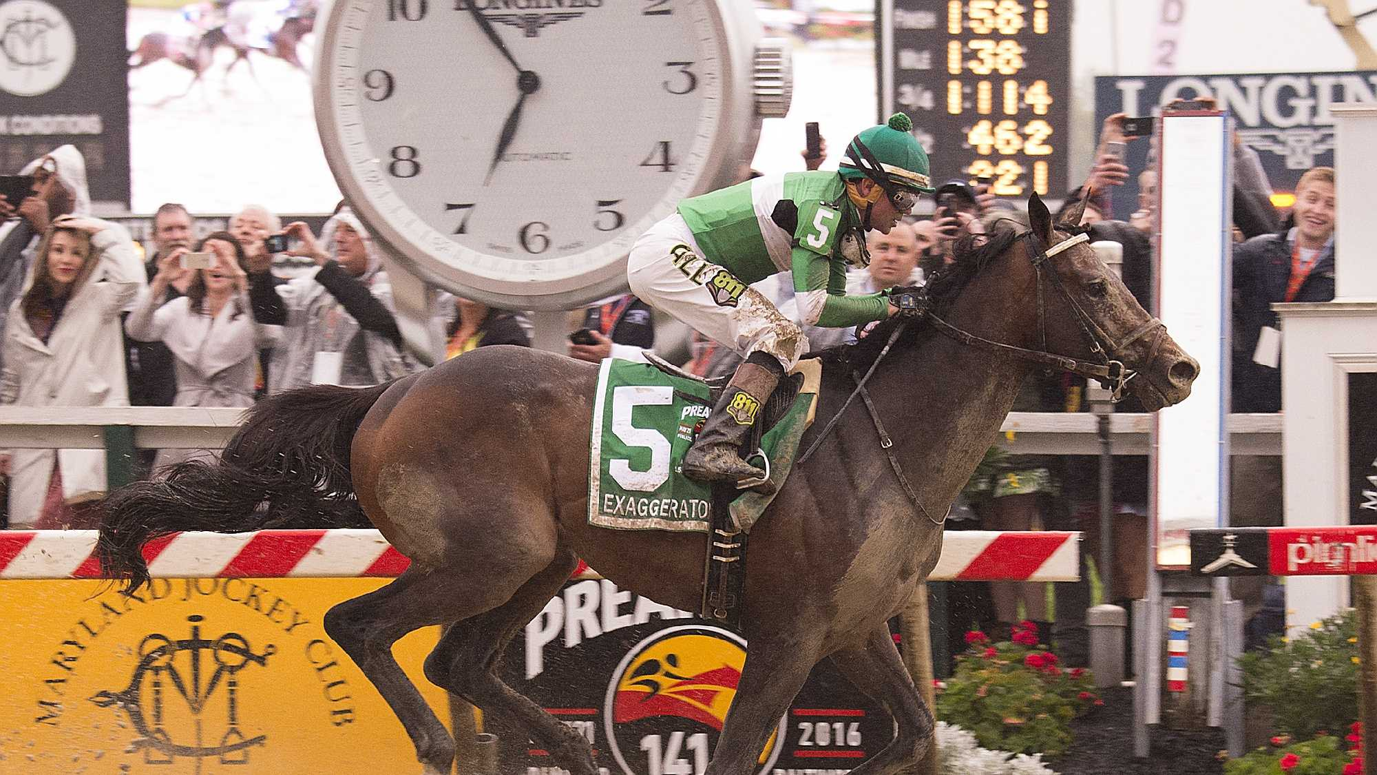 Exaggerator crosses the finish line at the 141st Preakness Stakes
