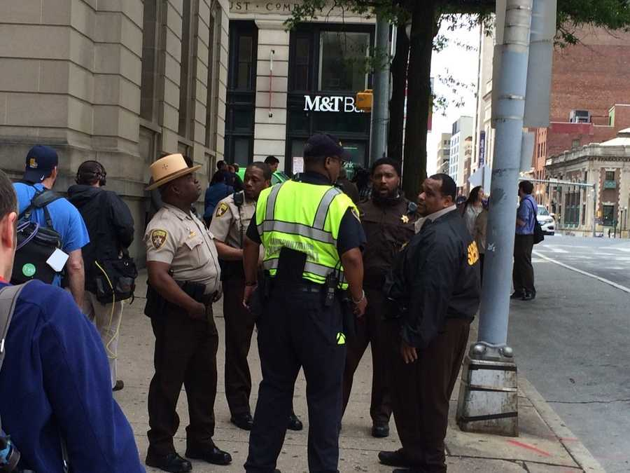 Deputies with the Baltimore Sheriff's Office man their posts outside Courthouse East after Baltimore police Officer Edward Nero was found not guilty of all charges in connection to the death of Freddie Gray.