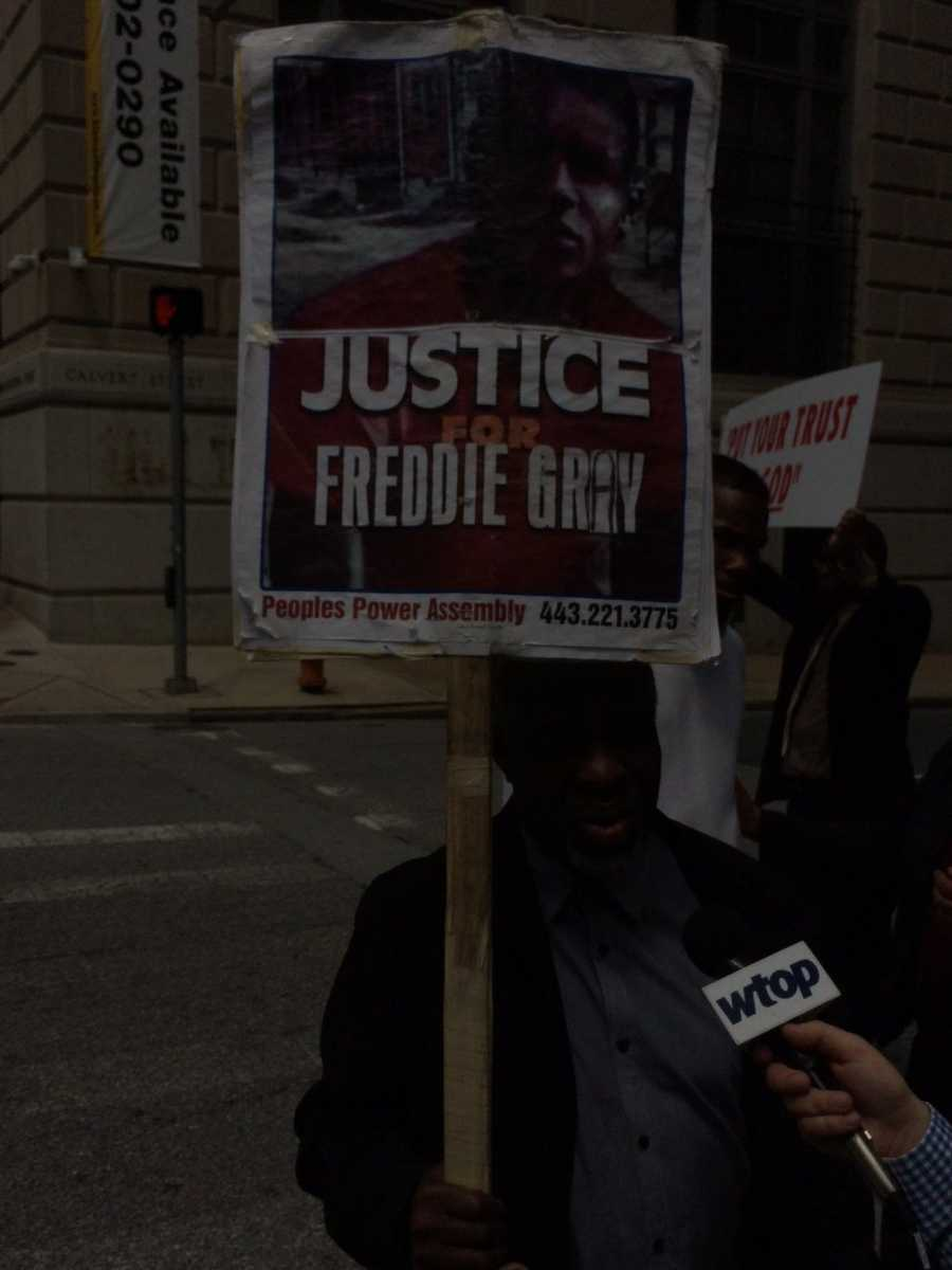 Baltimore resident Arthur Johnson protests after Officer Edward Nero was cleared of all charges in connection to the death of Freddie Gray.